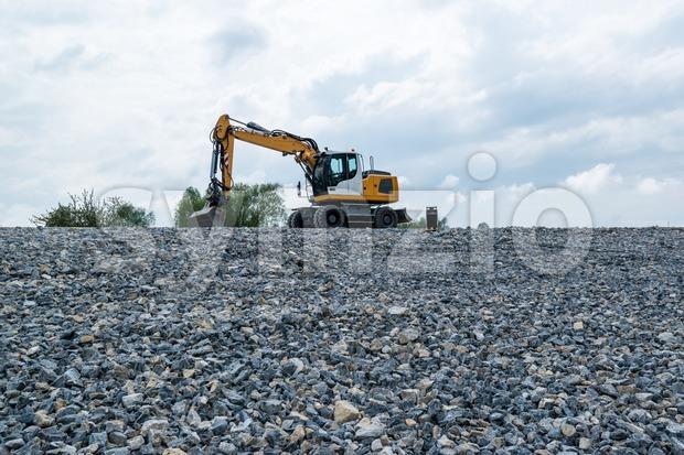 Excavator and plane Stock Photo