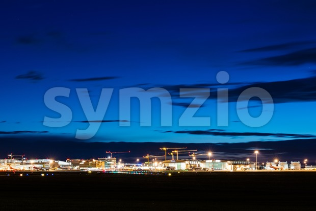 STUTTGART, GERMANY - MAY 6, 2014: Wide angle shot of Stuttgart Airport at dusk with planes departing and arriving as ...