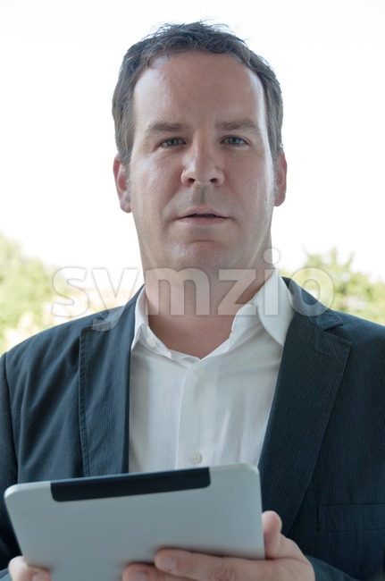 Salesman with digital tablet PC Stock Photo