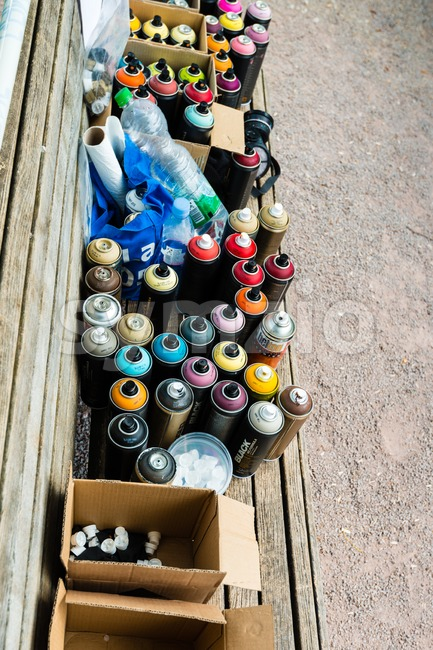 Graffiti spray cans and accessories Stock Photo