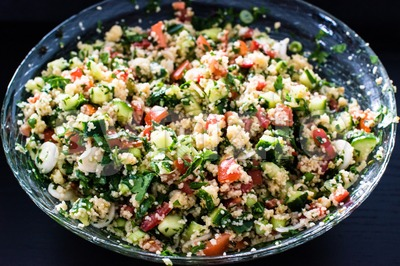 tabbouleh made of couscous and various vegetables Stock Photo