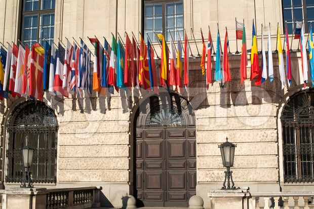 Set of international flags in front of Hofburg palace in Vienna, Austria