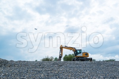 Excavator and plane Stock Photo
