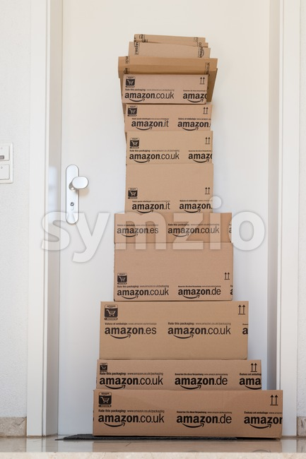 OSTFILDERN-SCHARNHAUSEN, GERMANY - MAY 18, 2014: A large stack of parcels by Amazon.com in different sizes is awaiting its customer ...
