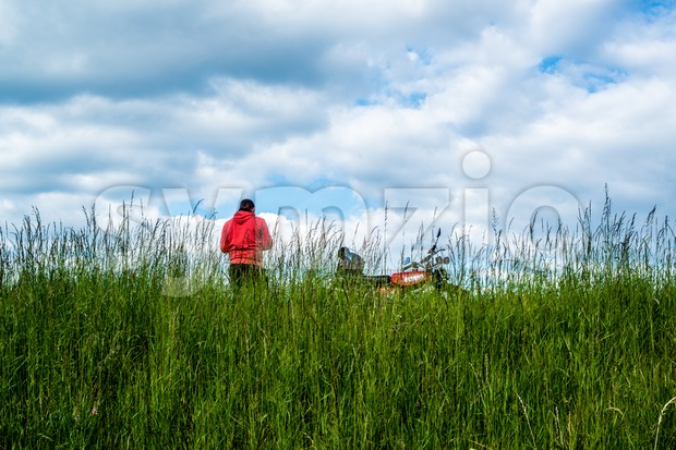Man with his moped having a break Stock Photo