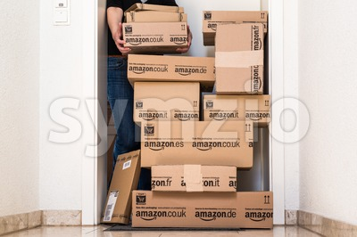 Woman receiving extensive Amazon.com delivery Stock Photo