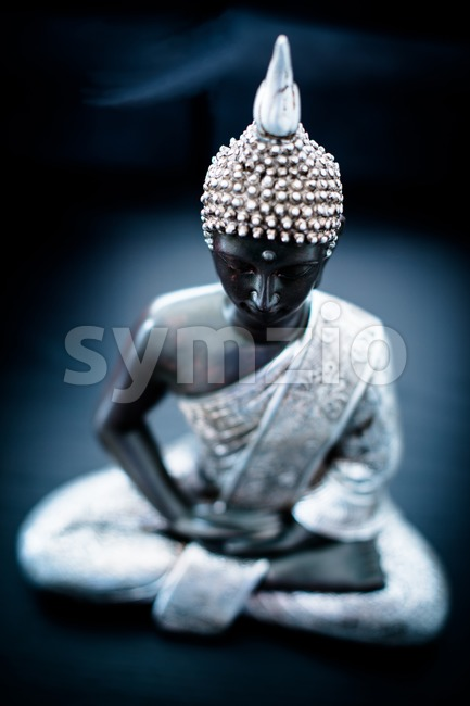 Meditation - statue of buddha Stock Photo