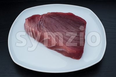 Large fresh and raw yellowfin tuna steak Stock Photo