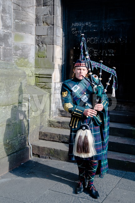 Scottish Bagpiper in Edinburgh Stock Photo