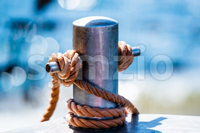 Abstract: Bollard and rope Stock Photo