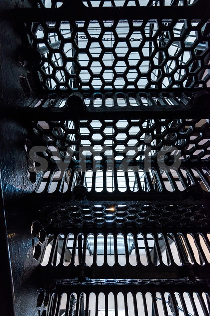 Abstract: View through a metal staircase in and old prison