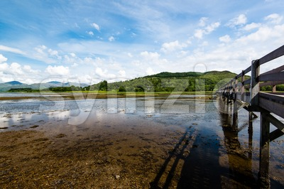 Scottish landscape with wooden footbridge Stock Photo