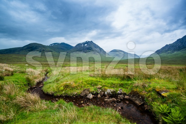 Beautiful landscape with Glencoe or Glen Coe mountains and pass with panoramic view over beautiful landscape in the Scottish Higlands, ...
