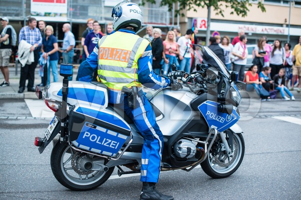 Police on motorbike during Christopher Street Day 2014 in Stuttgart Stock Photo