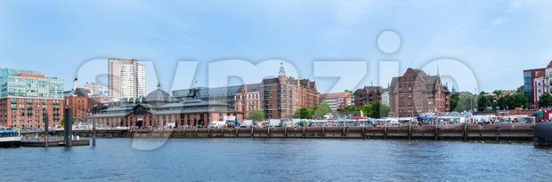 HAMBURG, GERMANY - JULY 20, 2014: People are enjoying the traditional Hamburg Fish Market in the early Sunday Morning on ...