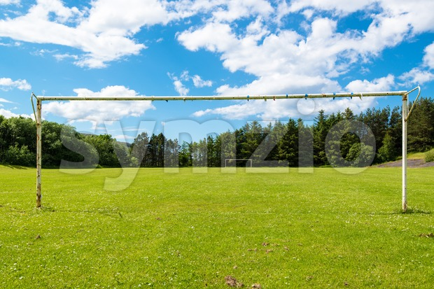 Empty soccer goal without a net on a great sunny summer day