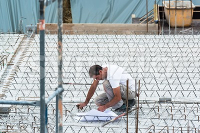 Eengineer checking a blueprint on a construction site Stock Photo