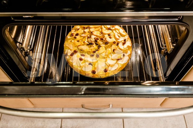 Apple pie in an oven Stock Photo