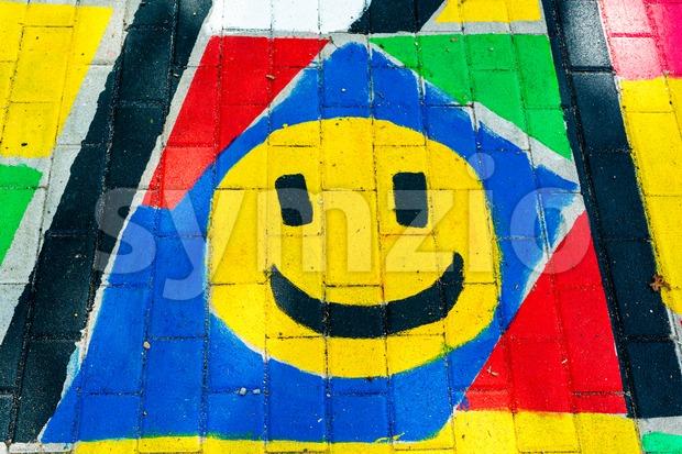 Smiley painting on the floor of a kindergarten