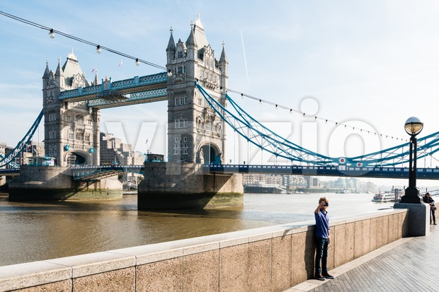 Young boy taking a selfie  in front of the Tower Bridge Stock Photo