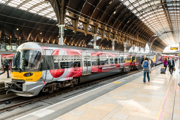 LONDON, UK - SEPTEMBER 26, 2014: The Heathrow Express train with Vodafone commercials promoting high speed internet is waiting at ...