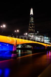 The Shard and London Bridge at Night Stock Photo