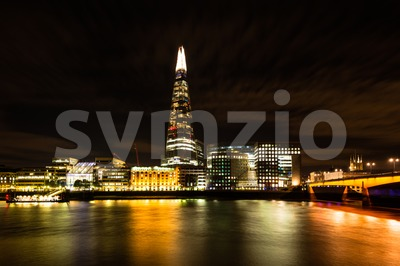 The Shard and London Bridge at Night Stock Photo
