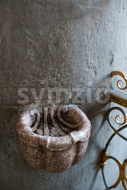 Stoup in catholic church Stock Photo