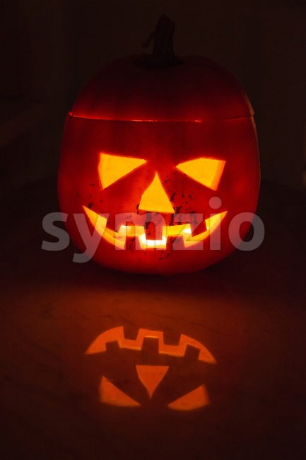 Illuminated halloween pumpkin Stock Photo