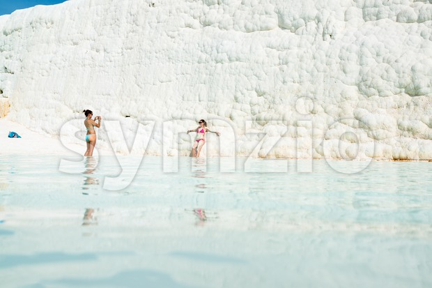 Young women in a travertine pool in Pamukkale, Turkey Stock Photo