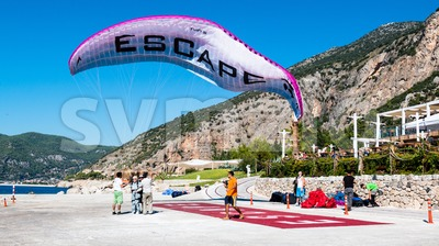 Tandem Paraglider Landing Stock Photo