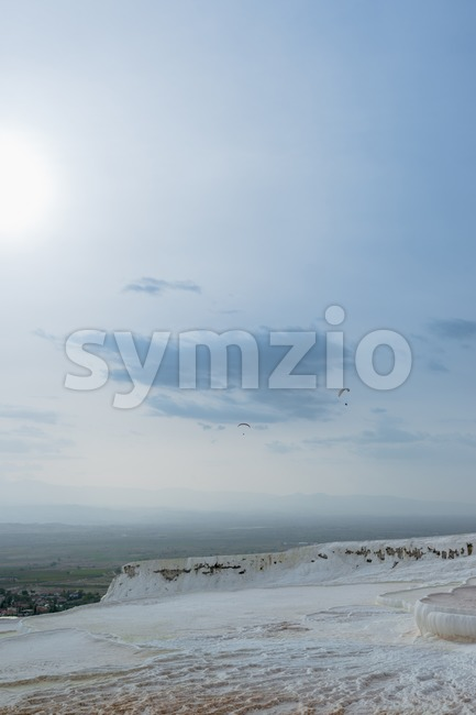 Paragliders over the travertine pools in Pamukkale, Turkey Stock Photo