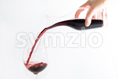 Red wine pouring into a glass Stock Photo