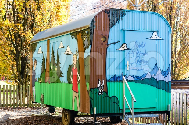 STUTTGART, GERMANY - NOVEMBER 08,2014: The forest Kindergarten Widmaierstrasse uses an old trailer previously used as contractor´s shed to educate ...