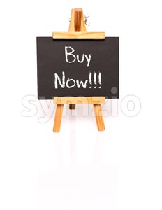 Buy Now. Blackboard with text and easel. Stock Photo