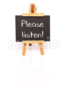 Please listen. Blackboard with text and easel. Stock Photo