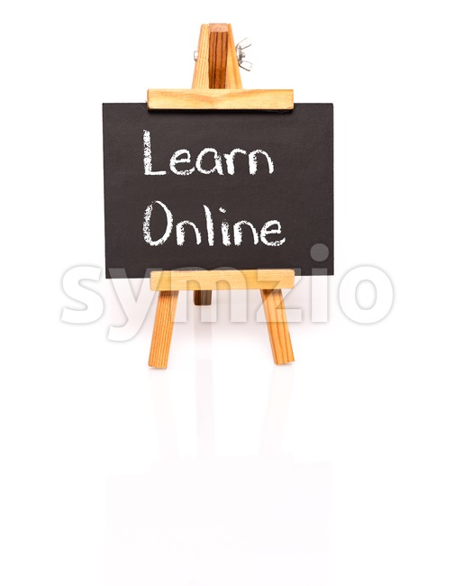 Learn Online. Blackboard with text and easel. Stock Photo