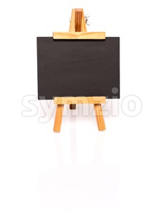 Empty blackboard with easel for your text Stock Photo