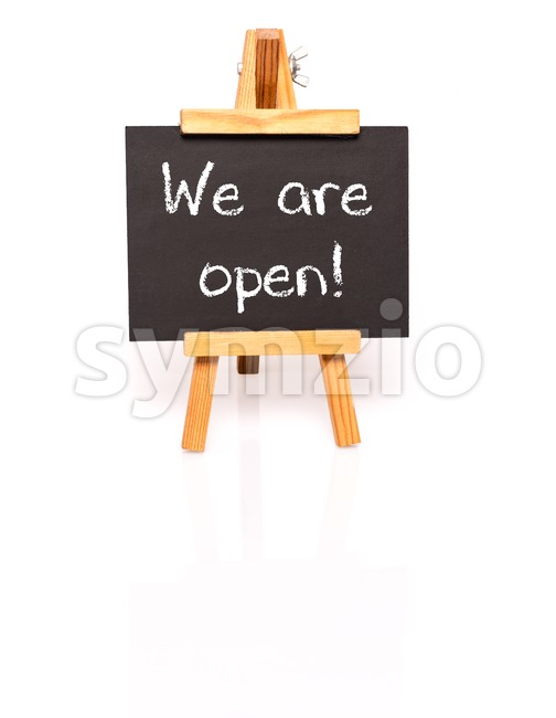 We are open. Blackboard with text and easel. Stock Photo