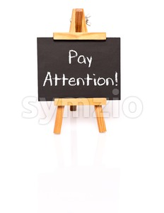 Pay attention. Blackboard with text and easel. Stock Photo