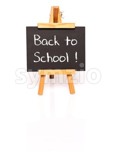 Back to school. Blackboard with text and easel. Stock Photo