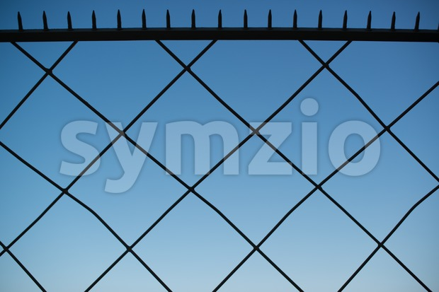 Spiked metal fence Stock Photo
