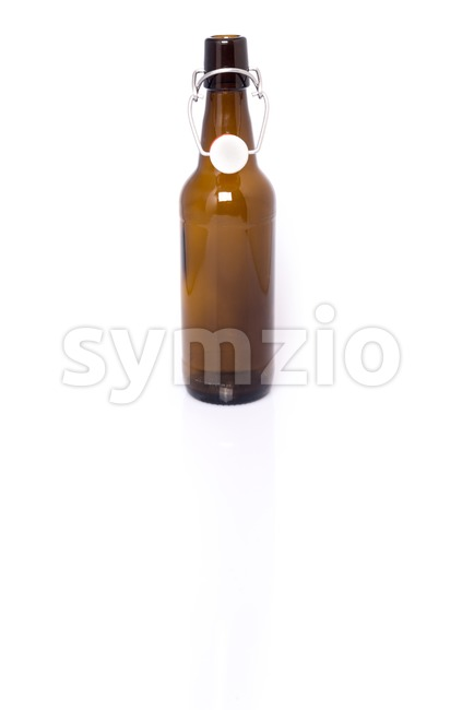 Old brown bottle of beer isolated on white. Stock Photo