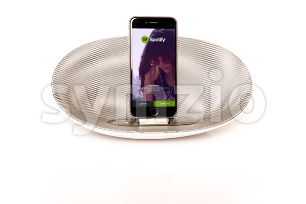 iPhone 6 with loudspeaker running Spotify Stock Photo