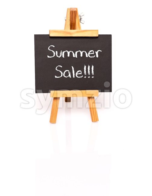 Summer Sale. Blackboard with text and easel. Photo on white background with shadow and reflection.