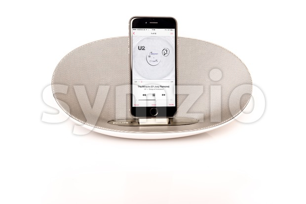 iPhone 6 with loudspeaker playing U2 Stock Photo