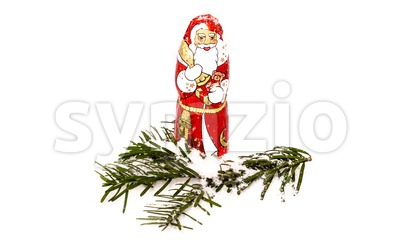 Chocolate Santa Claus in snow Stock Photo