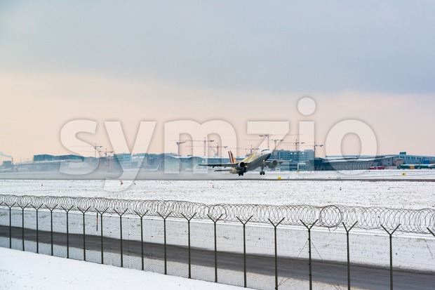 STUTTGART, GERMANY- DECEMBER 28, 2014: A Germanwings airplane is departing Stuttgart Airport on a frosty winter day on December 28, ...