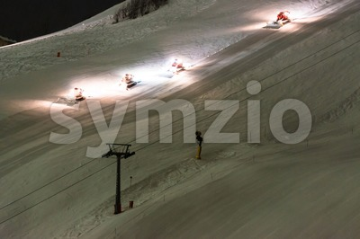 Snow groomer equipment at night Stock Photo
