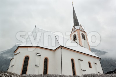 Beautiful church with mountains Stock Photo